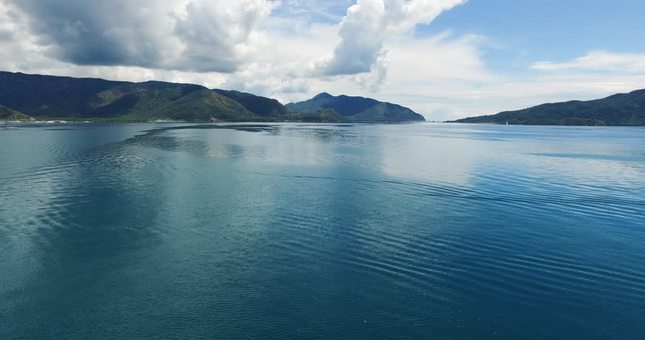 Camera moves back and show beautiful seaspace and mountains in Turkey, Marmaris. Aerial view shooting with drone.