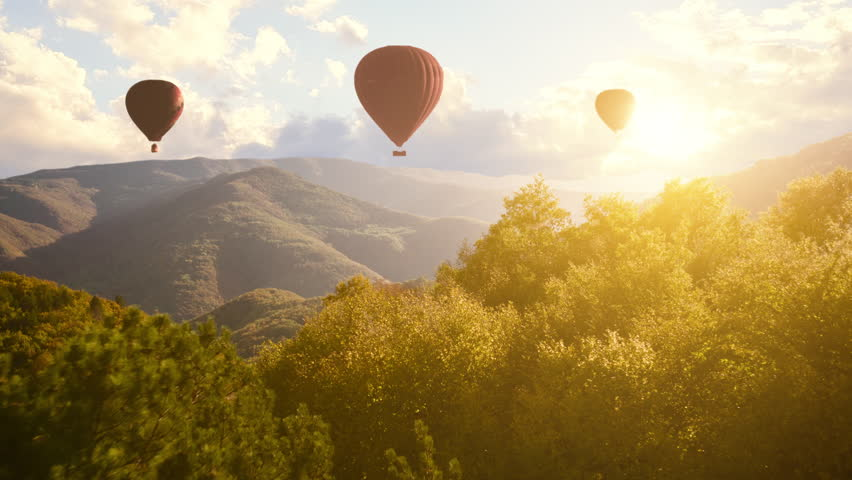 Hot Air Baloons Aerial Drone Flight Over Beautiful Autumn Forrest at Sunet Mountains Beautiful Landscape Background Sunny Vacation Travel Destination Concept #21576136