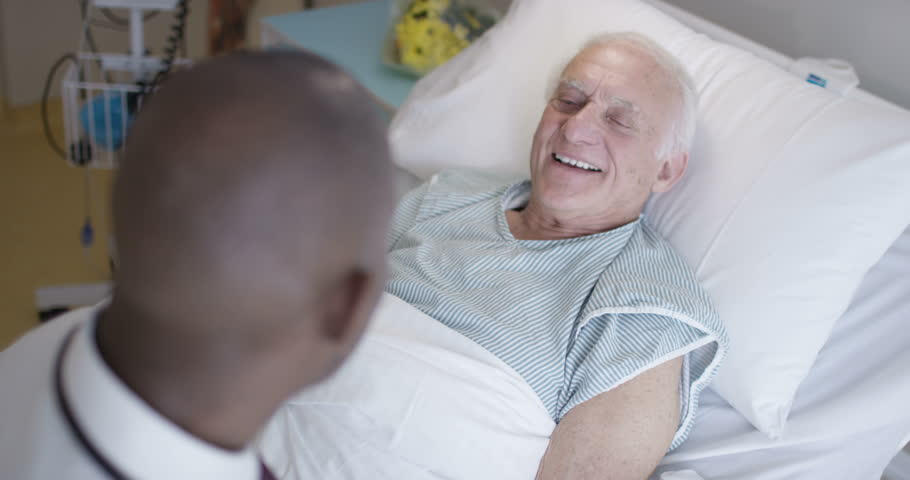 4K Friendly doctor talking to elderly patient at his bedside (UK-Oct 2016) | Shutterstock HD Video #21578296