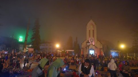 SAPA, LAO CAI, VIETNAM - NOVEMBER 4, 2016: View of the Catholic Holy Rosary church and main square at Sapa Town, Lao Cai Provice, North Vietnam.