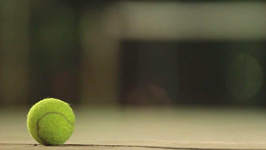 tennis ball dip on the ground #21588475