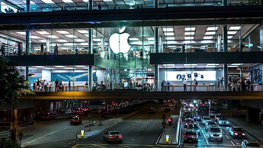 Hong Kong - October 2016: Night time lapse of Apple store with people and traffic. 4K resolution zoom out.