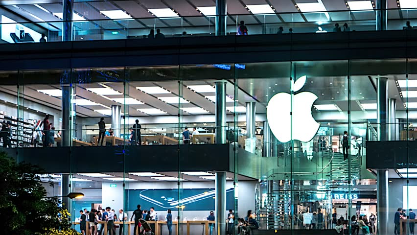 Hong Kong - October 2016: Night time lapse of Apple store with people. 4K resolution panning.