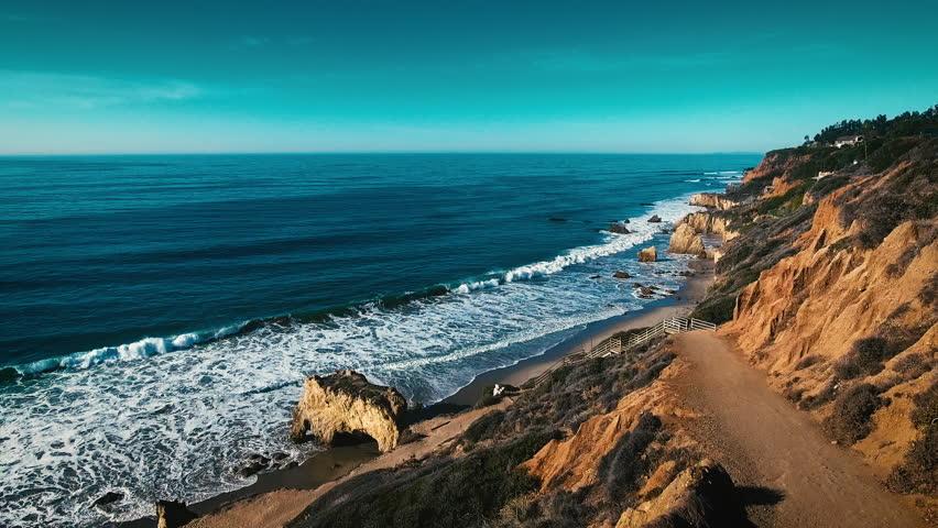 Deserted Wild El Matador Beach Malibu California Aerial Ocean View - Waves with Rocks
