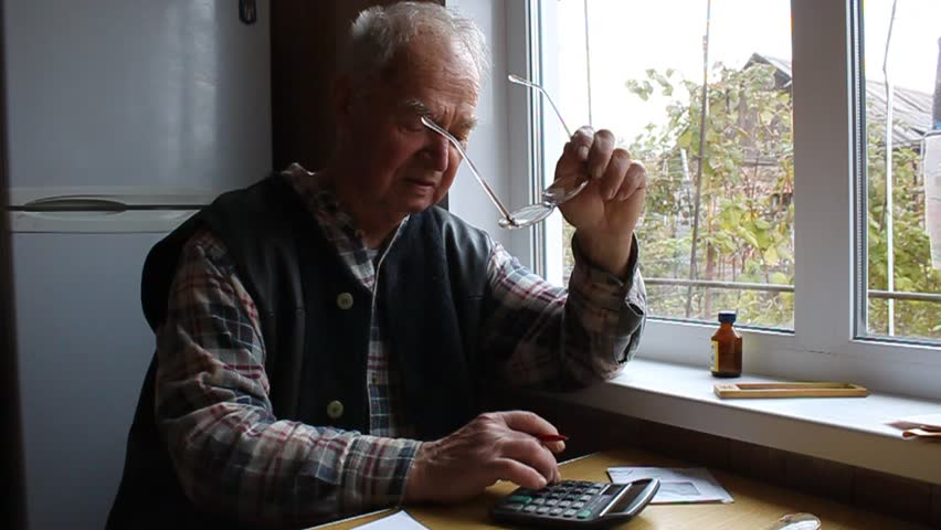 Old man with a calculator accounts #21604846