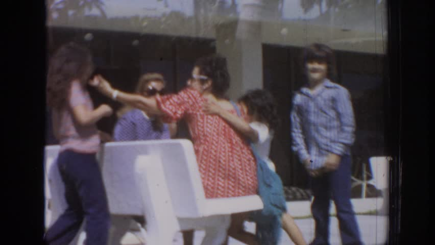 PHILADELPHIA PENNSYLVANIA 1972: a boy and his two sisters have fun in front of the camera during a family outing. | Shutterstock HD Video #21609571