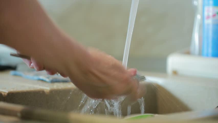 Woman washing plate in kitchen sink. women's hands | Shutterstock HD Video #21612481