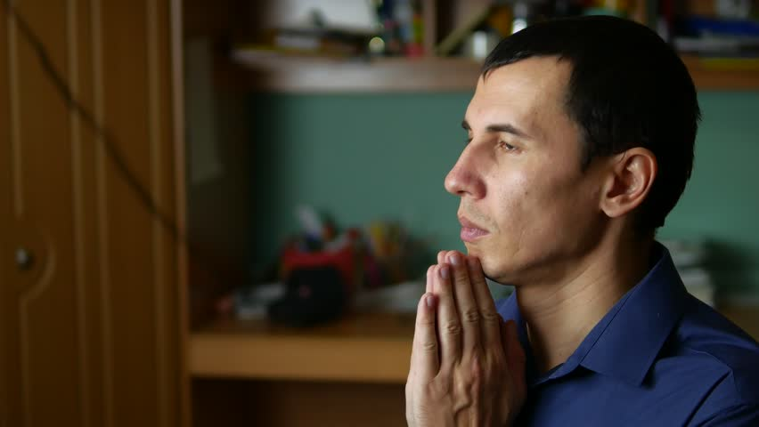 Middle-aged man praying god religion a indoor   Shutterstock HD Video #21624025