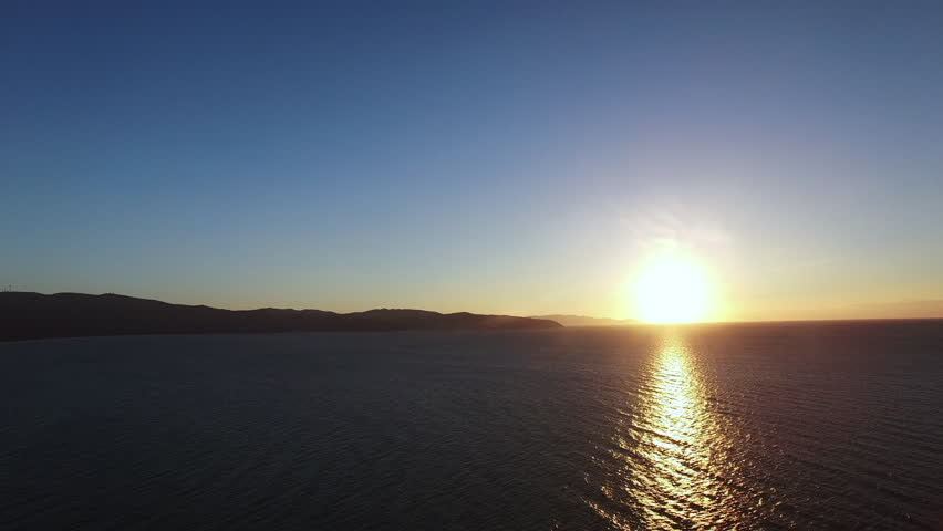 Aerial Sunset, Aerial drone video over the sea at the sunset in Italy near Monte Argentario. | Shutterstock HD Video #21627283