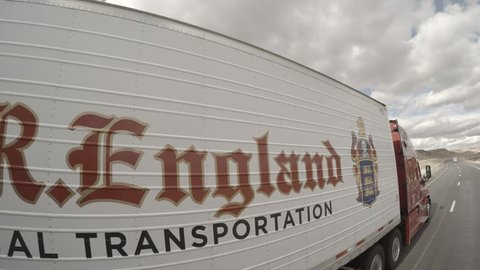 C.R. England Semi Truck Driving by,