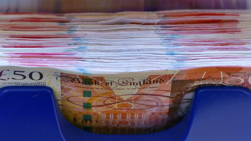 British Pound notes counted by a Currency counting machine  | Shutterstock HD Video #21651409