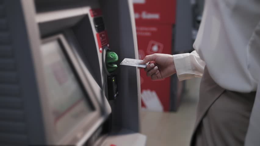 young woman inserting a credit card to ATM, beautiful girl banking Royalty-Free Stock Footage #21655144