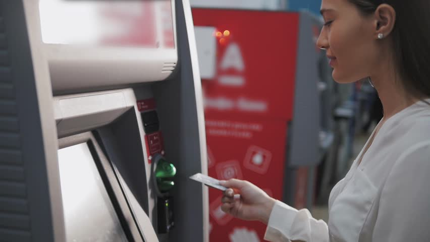 Young woman inserting a credit card to ATM, beautiful girl banking | Shutterstock HD Video #21655156
