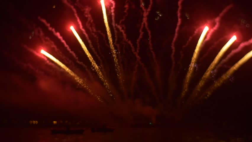 A Large Commercial Company Launches Their Fireworks on the Occasion of Celebrating of Anniversary of Opening. Many Beautiful White Sparks Fly Upwards. Bright Red Balls of Sparks, Following by Them, | Shutterstock HD Video #21668968