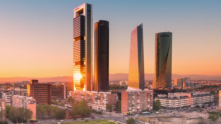 madrid skyline cityscape four towers financial center timelapse from day to night