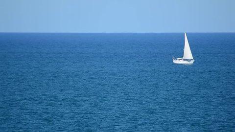 Small Sail Vessel Crossing Sea Horizon - La Manga, Mar Menor Side, Cabo de Palos, Cartagena and San Javier, Murcia, Spain, Europe