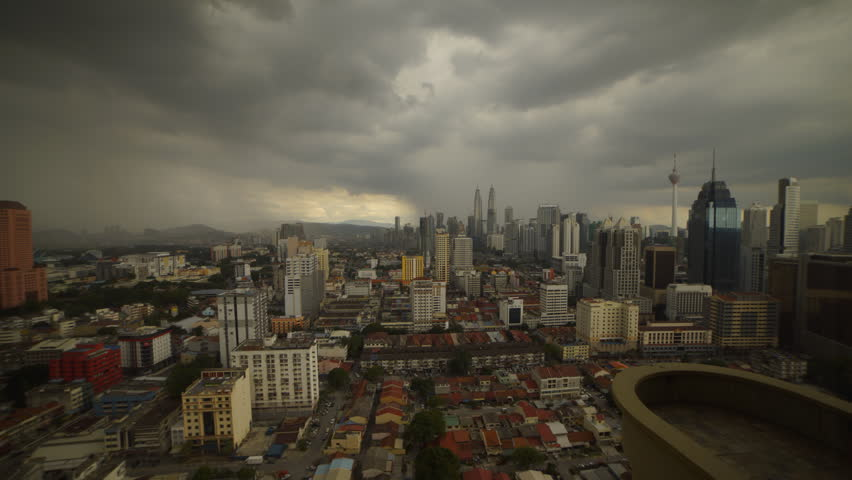 Kuala Lumpur Central Business District skyline during monsoon season time lapse | Shutterstock HD Video #21676672