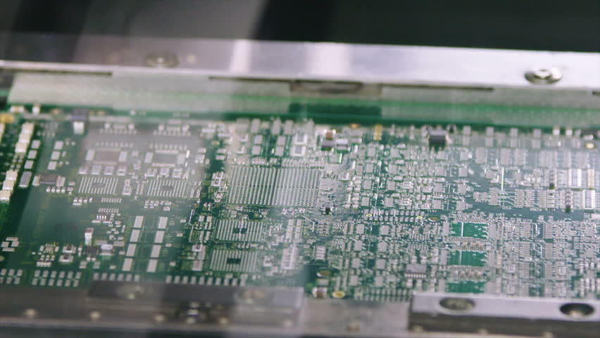 Surface Mount Technology (Smt) Machine places resistors, capacitors, transistors, LED and integrated circuits on circuit boards at high speed | Shutterstock HD Video #21678118