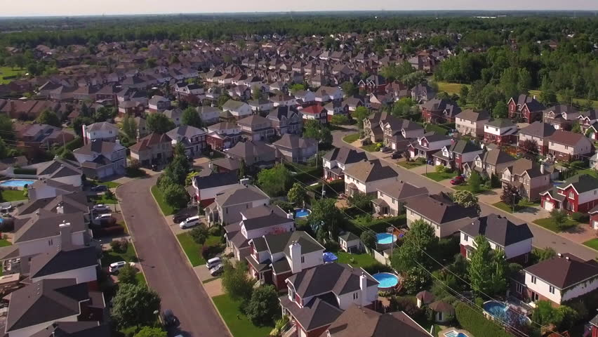 Aerial view of residential neighborhood in the suburbs of Montreal at sunset in Quebec, Canada.