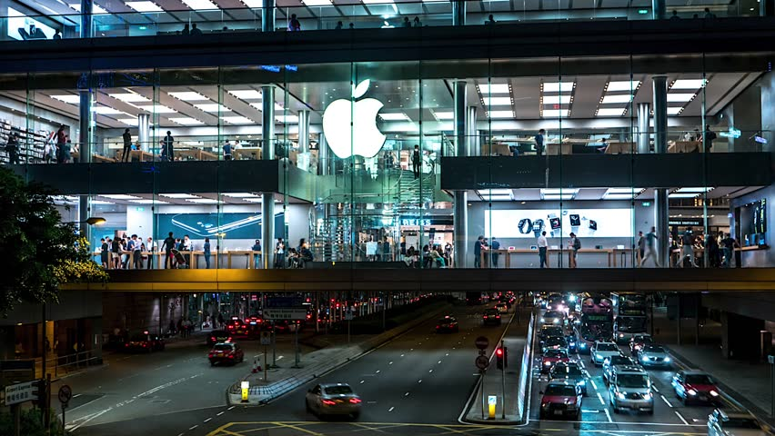 Hong Kong - October 2016: Night time lapse of Apple store with people and traffic. 4K resolution