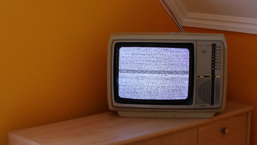 No signal just noise on a small TV in a dim room | Shutterstock HD Video #21706663