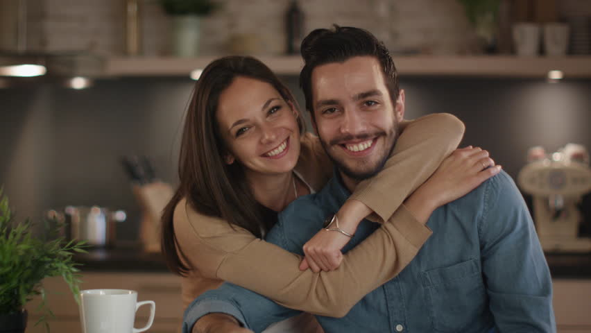 Portrait of a Handsome Smiling Couple in the Kitchen. Shot on RED Cinema Camera in 4K (UHD). | Shutterstock HD Video #21727747