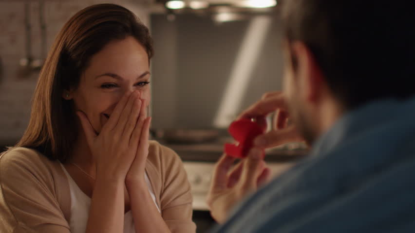 Close-up of a Handsome Young Man Proposing to His Girlfriend. He Opens Ring Box for Her She Takes the Ring and Wears it. Shot on RED Cinema Camera in 4K (UHD).
