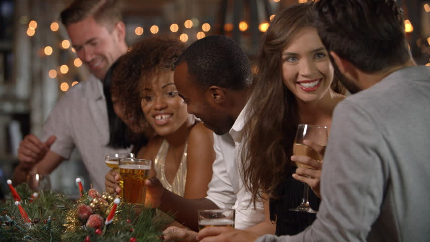 Friends making a toast at a Christmas party in a bar | Shutterstock HD Video #21728020