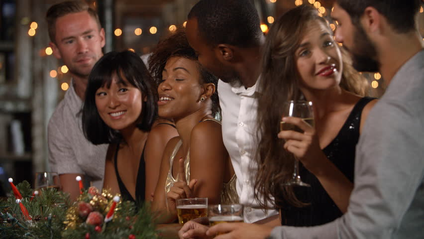 Friends talking by the bar at a  Christmas party #21728599