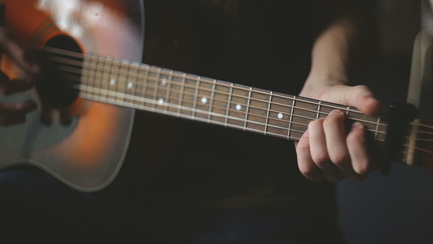 Creativity in focus. Close-up of men playing acoustic guitar. low contrast