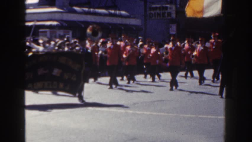 NEW YORK CITY 1962: a french flag followed by a huge parade with nice uniform #21744805