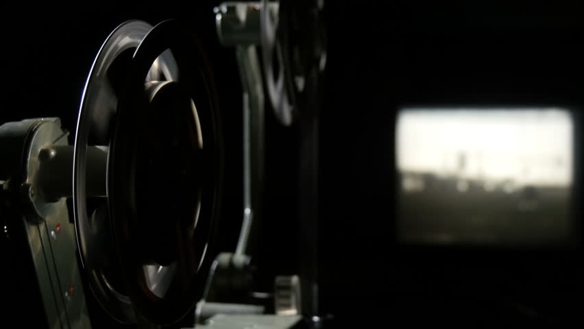 Old projector showing film, turning reel 3 | Shutterstock HD Video #21749752