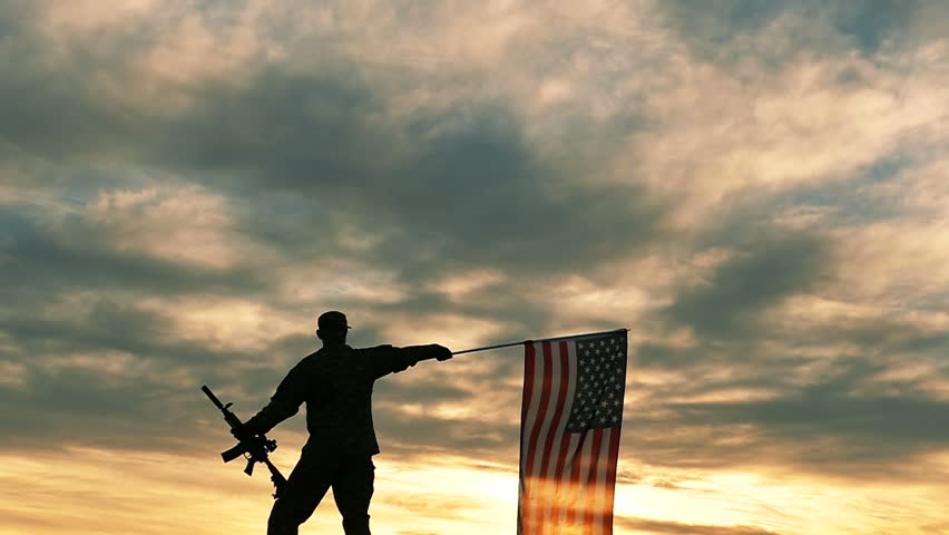 silhouette of Soldier with automatic rifle wave American Flag .Slow Motion.