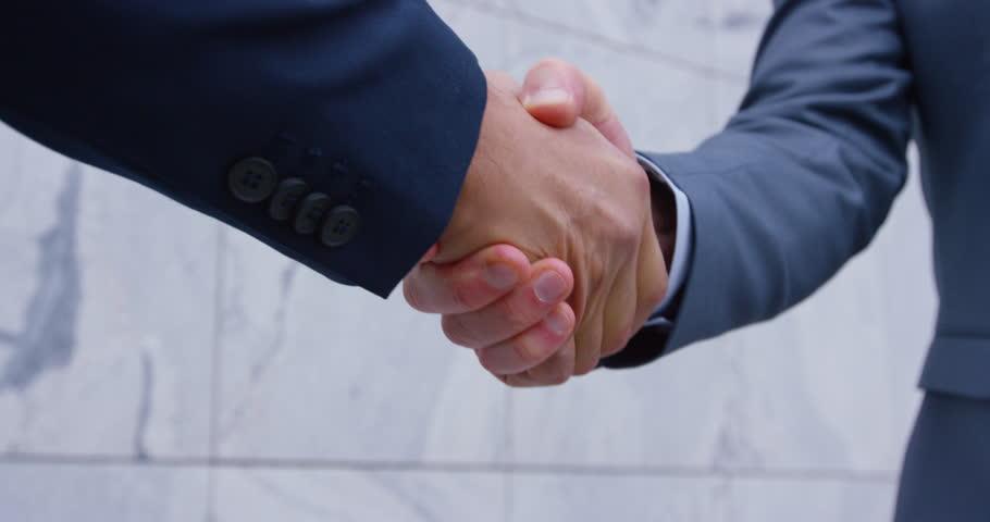 4K Cinemagraph: Close Up Of Senior Businessmen Shaking Hands Before Meeting | Shutterstock HD Video #21771097