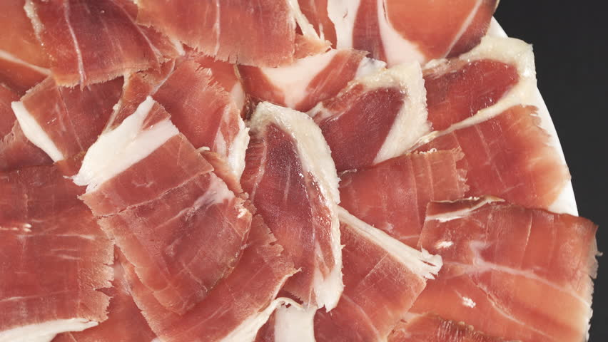 Top view of rotating acorn ham slices, closeup view
