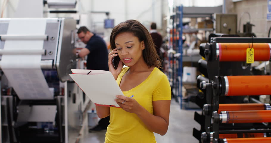 4K Confident female business manager in print factory doing business over the phone. Slow motion. | Shutterstock HD Video #21778855