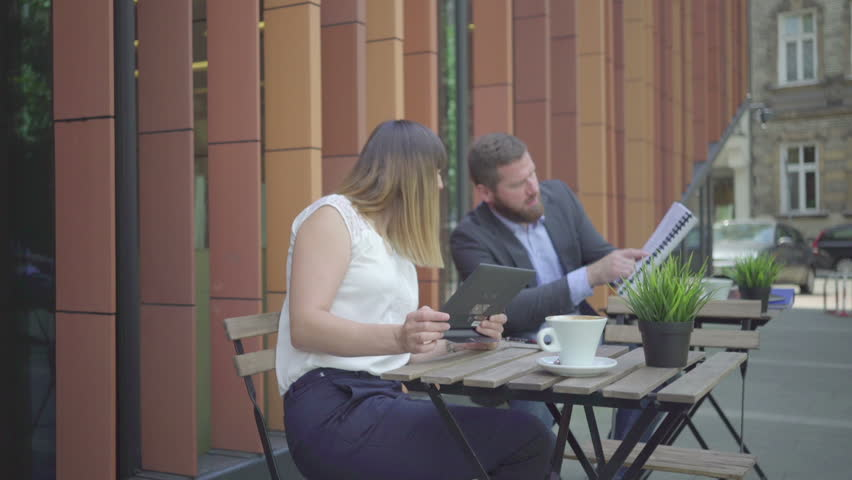 Businesspeople consulting data on tablet during work. Outdoor. Steadycam shot.   Shutterstock HD Video #21783223