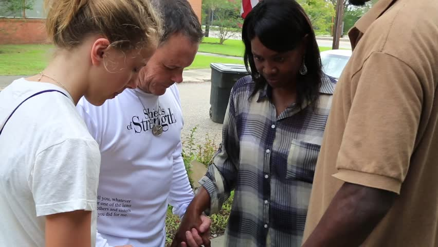 Denham Springs, Louisiana, Circa 2016: Victims of Flood and Relief Workers Pray Together | Shutterstock HD Video #21789865