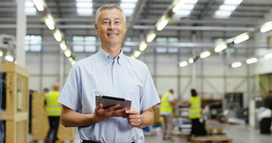 4k, Portrait of a mature manger using digital tablet in a warehouse. Slow motion. Royalty-Free Stock Footage #21793000