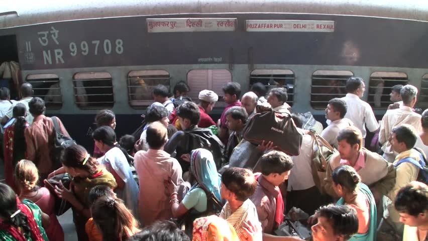 DELHI - NOV 13: People waiting for their trains in the Delhi Junction Railway Station on November 13, 2011 in Delhi, India. Delhi Junction is the oldest railway station of Delhi city.