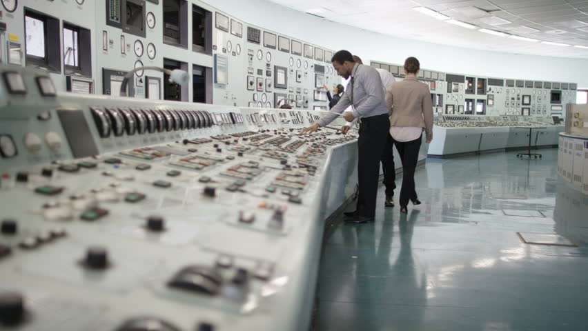 4K Workers in power plant control room, pressing switches on control panel (UK-Oct 2016)