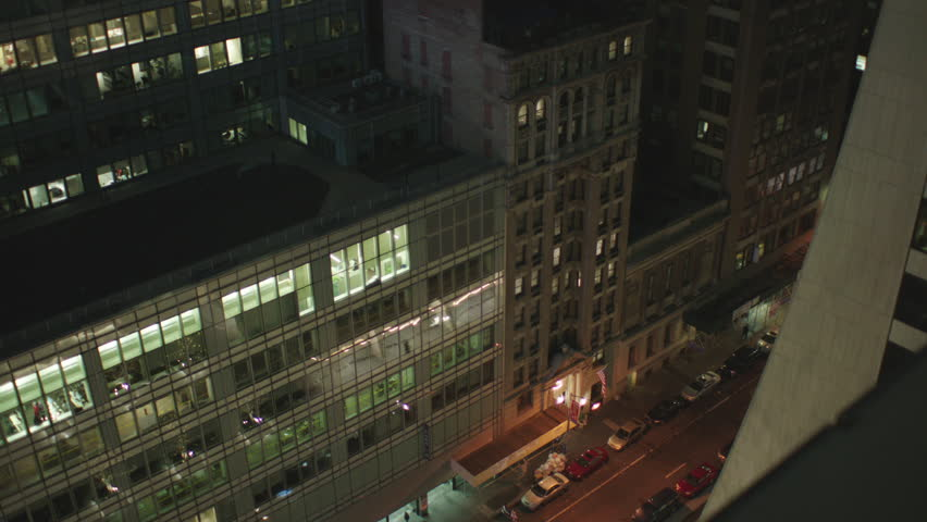 Night part large stitched together New York, rake, panorama Shot from rooftop ledge pointed down raked right roof part modern office building older office building entrance street pedestrians, | Shutterstock HD Video #21812758