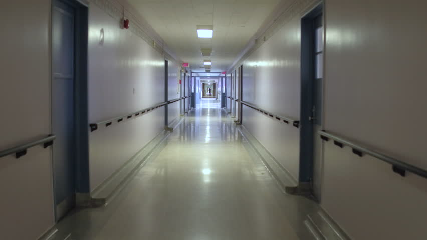 Steadicam walking down hospital hallway