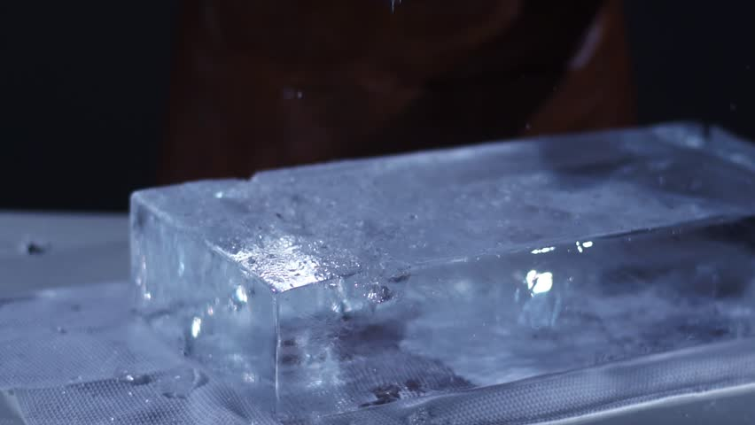 The barman crushing ice with special fork and breaking off a big piece of ice | Shutterstock HD Video #21835264
