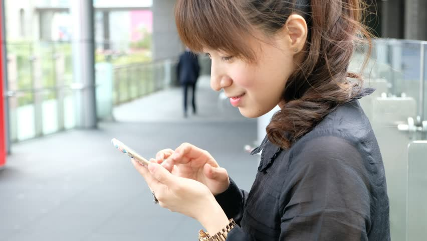 Woman use of smartphone at outdoor | Shutterstock HD Video #21839257