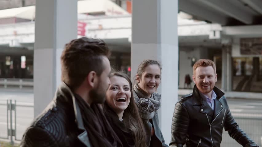 Two pretty young girls and two handsome men laugh happyily while walking in the city. Steadicam shot, slow mo | Shutterstock HD Video #21847741