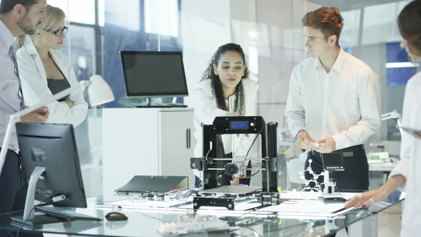 4K Scientific research engineers working in lab with computer and 3D printer (UK-Oct 2016)