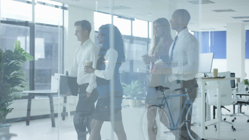 4K Young corporate business team arriving for a meeting in modern glass office (UK-Oct 2016) | Shutterstock HD Video #21854947