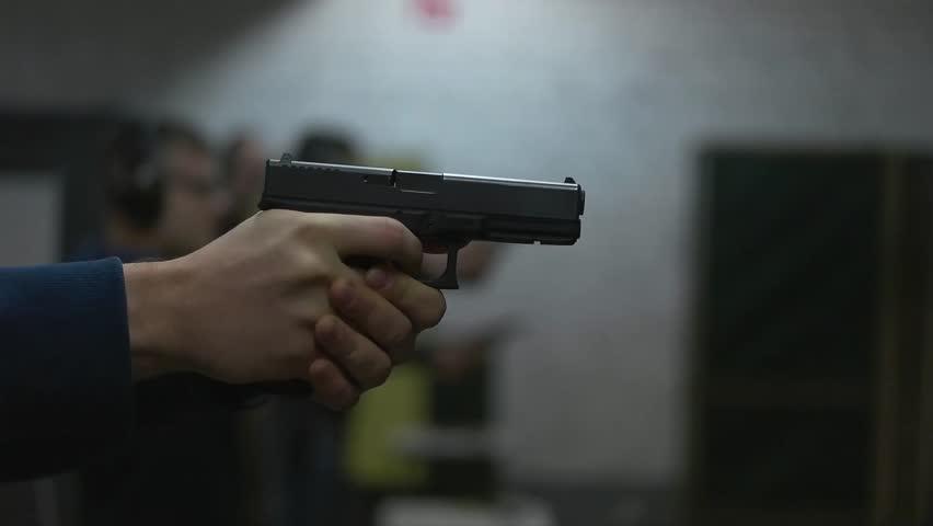 Man shoots a gun at shooting range. | Shutterstock HD Video #21856981