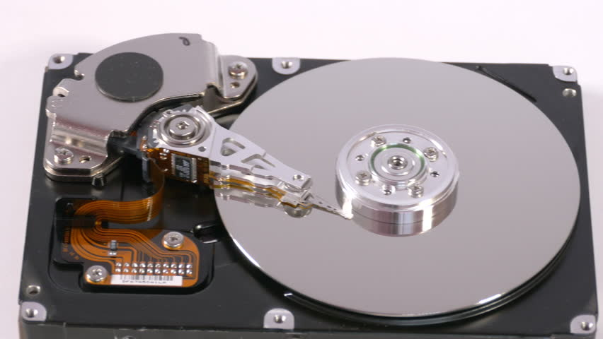 Data storage device,mechanism from inside on white surface, internals of hard disk drive, technology for retrieving digital information. Close up, 4K Ultra HD. | Shutterstock HD Video #21864472